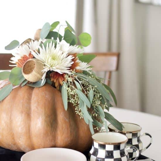 Floral arrangement inside of a pumpkin.